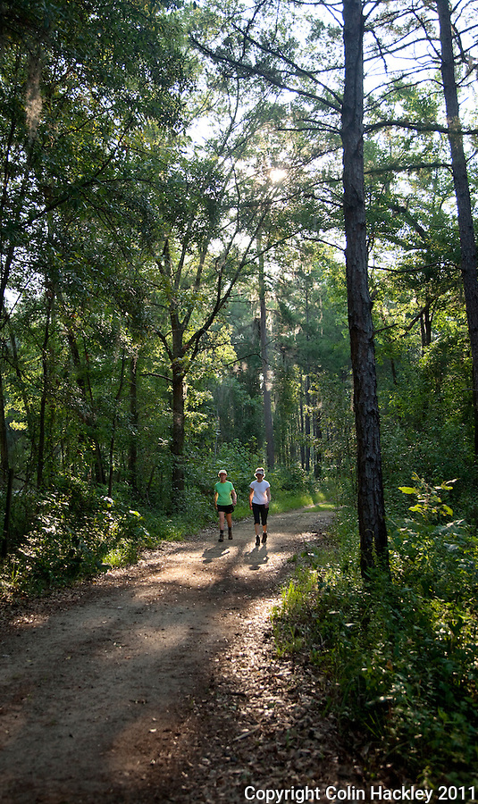ELINOR KLAPP-PHIPPS PARK: Walkers traverse a shared use trail near Gate A...COLIN HACKLEY PHOTO