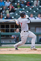 Tyler Austin (17) of the Scranton\Wilkes-Barre RailRiders follows through on his swing against the Charlotte Knights at BB&T BallPark on May 1, 2015 in Charlotte, North Carolina.  The RailRiders defeated the Knights 5-4.  (Brian Westerholt/Four Seam Images)