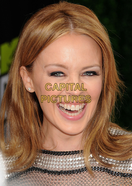Kylie Minogue.2013 MTV Movie Awards - Arrivals held at Sony Pictures Studios, Culver City, California, USA..14th April 2013.headshot portrait silver black studs studded metallic chainmail smiling mouth open.CAP/ADM/BP.©Byron Purvis/AdMedia/Capital Pictures