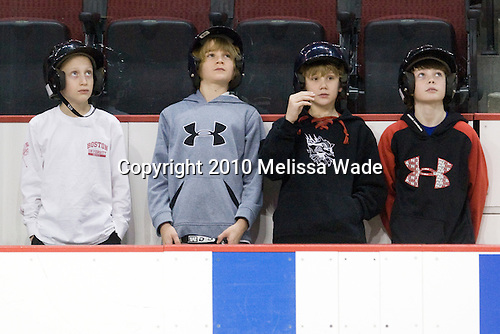 These four boys got to watch the teams warmup and then went on the ice to retrieve the pucks. - The Boston University Terriers defeated the visiting Harvard University Crimson 5-2 on Saturday, January 15, 2011, at Agganis Arena in Boston, Massachusetts.