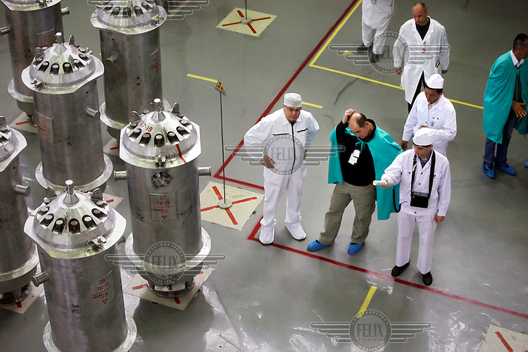 American-Ukrainian physicist Igor Bolshinsky (in green cape centre) inspects the transfer of highly enriched uranium (HEU) into casks at the Institute of Nuclear Physics in Almaty. The removal of Kazakhstan's HEU is part of the U.S. Global Threat Reduction Initiative (GTRI), where Bolshinsky works, which tries to secure nuclear material around the world to prevent their misuse.