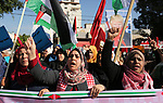 Palestinian women hold banners during a protest against US President Donald Trump's decision to recognise Jerusalem as the capital of Israel, in Gaza City on December 17, 2017. Photo by Ashraf Amra