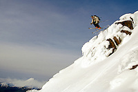 New Zealand, N. Island, Whakapapa, skier flying off cliff.