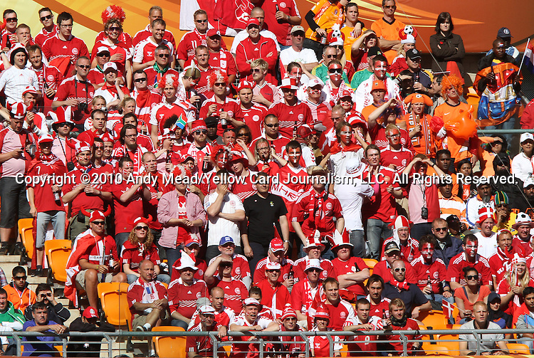 14 JUN 2010: A section of Denmark fans. The Netherlands National Team defeated the Denmark National Team 2-0 at Soccer City Stadium in Johannesburg, South Africa in a 2010 FIFA World Cup Group E match.