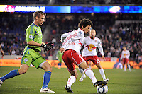 Mehdi Ballouchy (10) of the New York Red Bulls plays the ball as Jeff Parke (31) of the Seattle Sounders defends. The New York Red Bulls defeated the Seattle Sounders 1-0 during a Major League Soccer (MLS) match at Red Bull Arena in Harrison, NJ, on March 19, 2011.