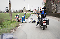 Ben Perry (CAN/Israel Cycling Academy) crashes in the back of the peloton while a following TV-motorbike (luckely) can safely stop behind him<br /> <br /> 69th Kuurne-Brussel-Kuurne 2017 (1.HC)
