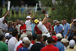 7 September 2008:   Surrounded by spectators, Camilo Villegas tees off in the fourth and final round of play at the BMW Golf Championship at Bellerive Country Club in Town & Country, Missouri, a suburb of St. Louis, Missouri on Sunday September 7, 2008. The BMW Championship is the third event of the PGA's  Fed Ex Cup Tour.