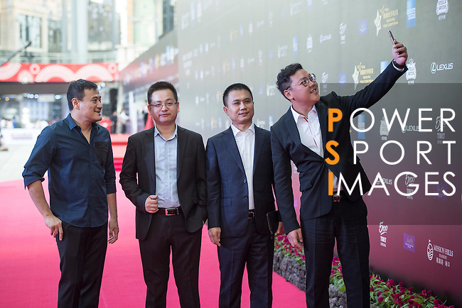 Jia Shengting, Alan Mak, and Cheng Denwei walk the Red Carpet event at the World Celebrity Pro-Am 2016 Mission Hills China Golf Tournament on 20 October 2016, in Haikou, China. Photo by Weixiang Lim / Power Sport Images