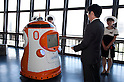 "August 01 2012, Tokyo, Japan - The president of Tokyo Tower, Shin Maeda hands over the employee ID to the new robot guide. Tokyo Tower implemented the new robot guide which name is ""Tawabo"", the first indoor robot guide in Japan. It can speak Japanese, English, Chinese and Korean, it weights 200kg and it is 160cm tall."
