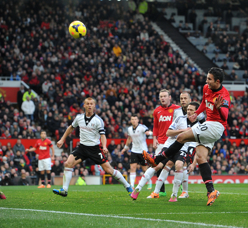 Manchester United's Robin van Persie tries to lob Fulham's goalkeeper Maarten Stekelenburg (not in view)<br /> <br /> Photo by Dave Howarth/CameraSport<br /> <br /> Football - Barclays Premiership - Manchester United v Fulham - Sunday 9th February 2014 - Old Trafford - Manchester<br /> <br /> &copy; CameraSport - 43 Linden Ave. Countesthorpe. Leicester. England. LE8 5PG - Tel: +44 (0) 116 277 4147 - admin@camerasport.com - www.camerasport.com