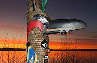 TA47045-D. Totem pole along the British Columbia coastline at sunset. Canada, Pacific Ocean.<br /> Photo Copyright &copy; Brandon Cole. All rights reserved worldwide.  www.brandoncole.com