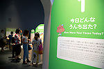 """Visitors see different kind of animal and human feces at the Toilet!? Human Waste & Earth's Future exposition on August 1, 2014 in Tokyo, Japan. The Toilet!? Human Waste & Earth's Future is an exposition to listen the toilet's voice and explore what is the """"happy toilet"""" for each human being on the earth at National Museum of Emerging Science and Innovation in Tokyo from July 2 to October 5. The toilet is related not only to our daily life but also to the global environment. The exposition consist of eight areas where you can learn toilet problems for each generation and in the world. (Photo by Rodrigo Reyes Marin/AFLO)"""