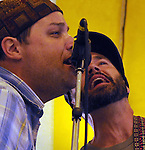 Left to right- Jeb Puryear and Kyle Spark, singing harmony with, Donna The Buffalo band, performing on the Dance Stage of the 2012 Clearwater Festival at Croton Point Park on Saturday, June 16, 2012. Photograph taken by Jim Peppler. Copyright Jim Peppler/2012.