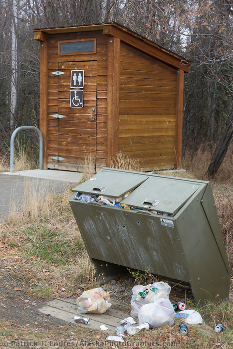 Trash overflows from the bear proof trash containers along the Elliot Highway.