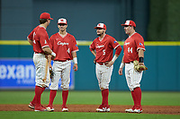 Cooper Coldiron (4), Connor Hollis (5) and Joe Davis (44)  of the Houston Cougars talk with pitcher Tyler Bielamowicz (13) during a break in the action against the Vanderbilt Commodores during game nine of the 2018 Shriners Hospitals for Children College Classic at Minute Maid Park on March 3, 2018 in Houston, Texas. The Commodores defeated the Cougars 9-4. (Brian Westerholt/Four Seam Images)