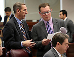Nevada Senate Republicans, from left, Scott Hammond, Ben Kieckhefer and Michael Roberson work on the Senate floor at the Legislative Building in Carson City, Nev., on Wednesday, April 15, 2015.<br /> Photo by Cathleen Allison