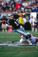 OAKLAND, CA - Quarterback Rich Gannon of the Oakland Raiders in action during a game against the Kansas City Chiefs at the Oakland Coliseum in Oakland, California on November 5, 2000. Photo by Brad Mangin