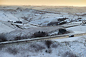11/12/14<br /> <br /> A snow covered car drives along the A53 between Buxton and Leek. The view from Axe Edge looking towards the Manifold Valley after overnight snow fall settles on hills in the Derbyshire Peak District.<br /> <br /> ***ANY UK EDITORIAL PRINT USE WILL ATTRACT A MINIMUM FEE OF &pound;130. THIS IS STRICTLY A MINIMUM. USUAL SPACE-RATES WILL APPLY TO IMAGES THAT WOULD NORMALLY ATTRACT A HIGHER FEE . PRICE FOR WEB USE WILL BE NEGOTIATED SEPARATELY***<br /> <br /> <br /> All Rights Reserved - F Stop Press. www.fstoppress.com. Tel: +44 (0)1335 300098