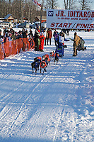 Saturday, February 24th, Knik, Alaska.  Jr. Iditarod musher Rohn Buser leaves start line on Knik Lake