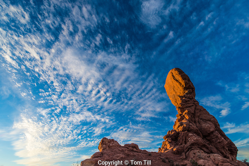 Balanced Rock and clouds, Arches National Park, Utah Entrada sandstone
