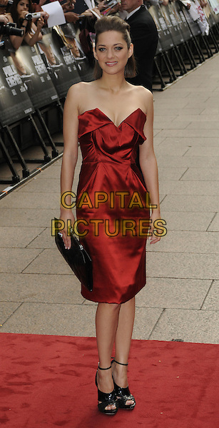 MARION COTILLARD.European Premiere of 'Public Enemies' at the Empire Cinema, Leicester Square, London, England..June 29th 2009.full length red strapless silk satin dress clutch bag black shoes.CAP/CAN.©Can Nguyen/Capital Pictures.