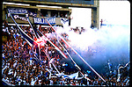 Fans light a flare during the championship match between Racing Club and Velez.