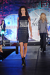 A model walks the runway wearing fashions from Tory Burch at the Fall Fashion show at the Galleria Thursday  Oct. 16,2008. (Dave Rossman/For the Chronicle)