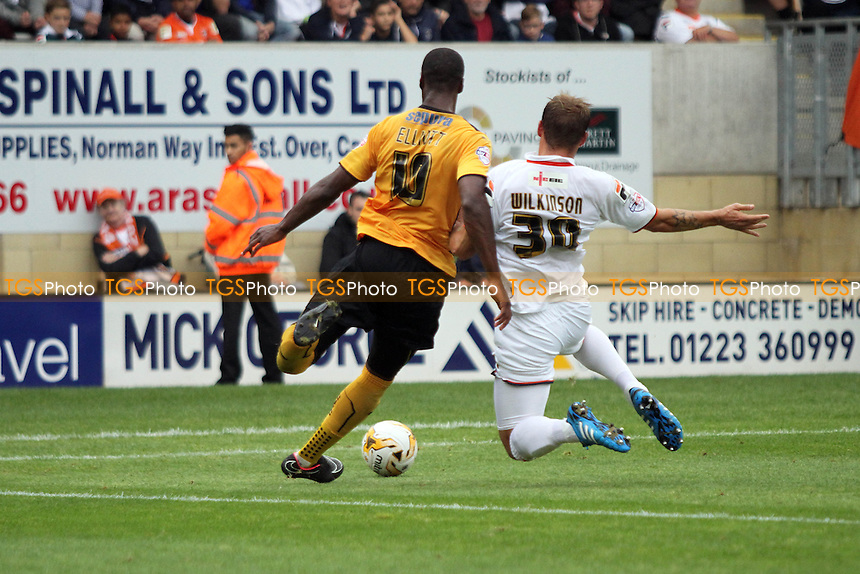 Tom Elliott (Cambridge United) and Luke Wilkinson (Luton Town) go for the ball - Cambridge United vs Luton Town - Sky Bet League Two Football at the Abbey Stadium, Cambridge - 20/09/14 - MANDATORY CREDIT: Mick Kearns/TGSPHOTO - Self billing applies where appropriate - contact@tgsphoto.co.uk - NO UNPAID USE