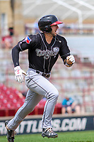 Lansing Lugnuts shortstop Kevin Smith (4) races to first base during a Midwest League game against the Wisconsin Timber Rattlers on May 8, 2018 at Fox Cities Stadium in Appleton, Wisconsin. Lansing defeated Wisconsin 11-4. (Brad Krause/Four Seam Images)