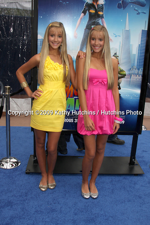 """Milly & Becky Rosso  arriving at the Los Angeles Premiere of """"Monsters Vs. Aliens"""" at Gibson Ampitheatre in Universal City, CA on  March 22,  2009 .©2009 Kathy Hutchins / Hutchins Photo...                ."""