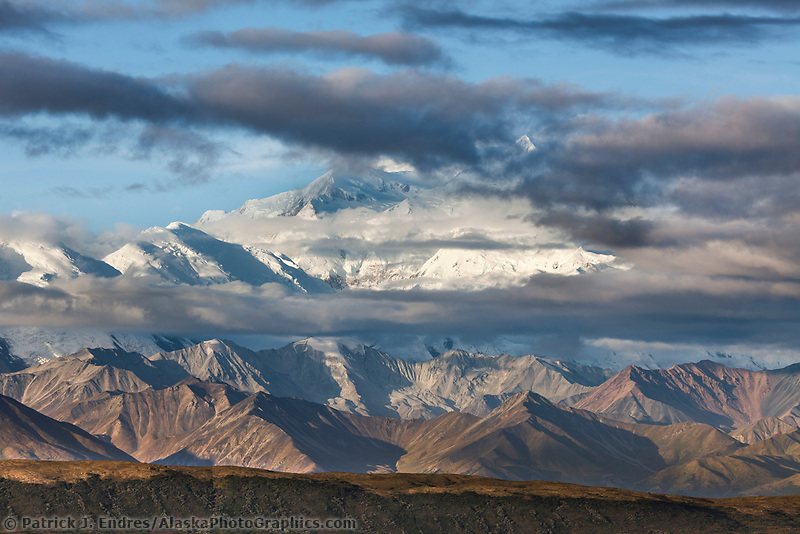Late Morning Clouds Form Over The Summit Of Mt. Denali, North America's Largest Mountain, Denali National Park, Interior, Alaska.