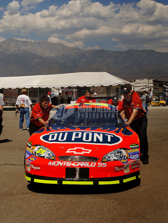 Sept. 2, 2006; Fontana, CA, USA; Crew members push the car of Nascar Nextel Cup driver Jeff Gordon (24) during practice for the Sony HD 500 at California Speedway. Mandatory Credit: Mark J. Rebilas