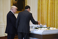 AT&amp;T Senior Executive Randall Stephenson (R) explains to United States President Donald J. Trump how the 5G will be deployed in cities  during the American Leadership in Emerging Technology Event in the East Room of the White House in Washington, DC, on June 22, 2017. <br /> Credit: Olivier Douliery / Pool via CNP /MediaPunch