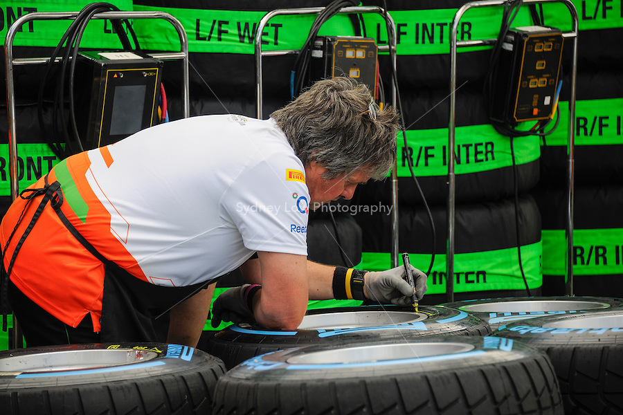 MELBOURNE, 18 March - Mechanics prepare tyres ahead of the start of the 2012 Formula One Australian Grand Prix at the Albert Park Circuit in Melbourne, Australia. (Photo Sydney Low / syd-low.com)