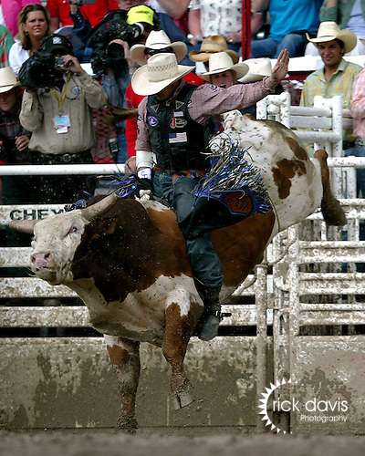 PRCA cowboy Clint Craig scores a 92 point bull ride in the short go of the 111th Cheyenne Frontier Days rodeo on July 29, 2007. Clint posted a three head total of 249.
