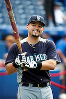 Seattle Mariners catcher Jesus Montero #63 during batting practice before an American League game against the Toronto Blue Jays at the Rogers Centre on September 13, 2012 in Toronto, Ontario.  (Mike Janes/Four Seam Images)