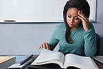 USA, California, Oakland, Young woman reading textbox