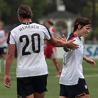 USWNT'S Abby Wambach (20) and Megan Rapinoe (15) slap hands. The U.S. Women's National Team defeated Canada 1-0 in a friendly match at Marina Auto Stadium in Rochester, NY on July 19, 2009. Abby Wambach of the USWNT scored her 100th career goal in the second half..