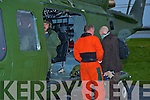 Air Corps personnel examine the helicopter that lost its door while carrying Minister Martin Cullen, and made an emergency landing at Killarney Golf and Fishing club on Monday......