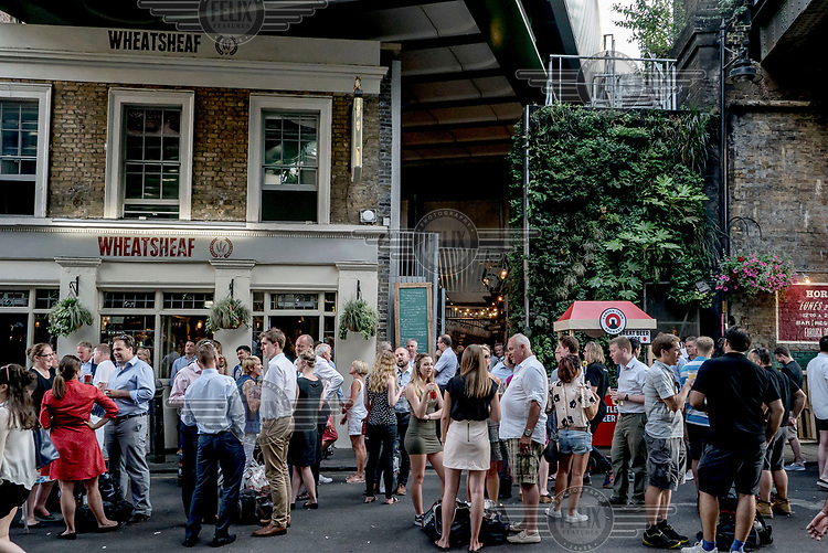 People gather in the early evening outside the Wheatsheaf pub in Borough Market.