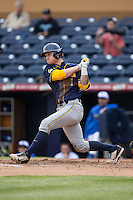 Robbie Tenerowicz (1) of the California Golden Bears follows through on his swing against the Duke Blue Devils at Durham Bulls Athletic Park on February 20, 2016 in Durham, North Carolina.  The Blue Devils defeated the Golden Bears 6-5 in 10 innings.  (Brian Westerholt/Four Seam Images)