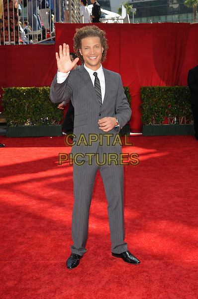 JUSTIN GUARINI.Arrivals at the 61st Primetime Emmy Awards held at Te Nokia Theater in Los Angeles, California, USA. .September 20st, 2009 .emmys full length grey gray tie pinstripe white shirt suit jacket hand palm waving .CAP/ROT.©Lee Roth/Capital Pictures