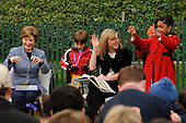 "Jenna Bush, right center, does a lion imitation as she reads from the book, ""Where the Wild Things Are,"" as her mother First Lady Laura Bush, left, looks on to kids at the annual White House Easter Egg Roll March 24, 2008 on the South Lawn of the White House in Washington, DC. The Easter Egg Roll is a traditional all-American event held on the White House lawn each year since 1878, where kids compete by using a giant wooden spoon to push an egg.  <br /> Credit: Ken Cedeno / Pool via CNP"