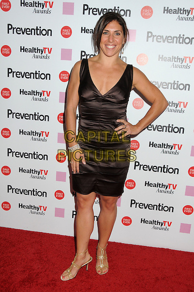 "Ilyse Baker.Prevention Magazine Presents the Inaugural ""Prevention Healthy TV Awards"" held at The Paley Center for Media, Beverly Hills, California, USA..September 27th, 2011.full length black dress hand on hip sleeveless brown silk satin.CAP/ADM/BP.©Byron Purvis/AdMedia/Capital Pictures."