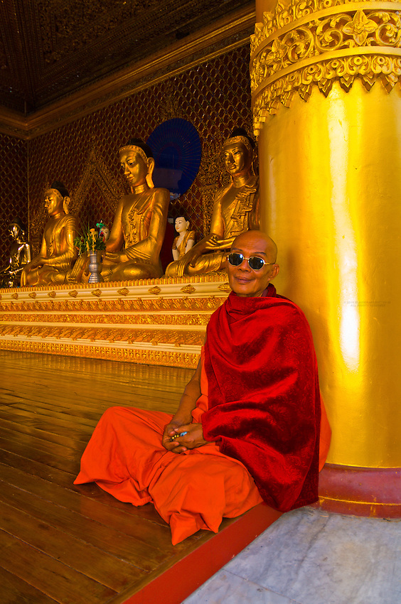 Buddhist monk wearing sunglasses, Shwedagon Pagoda, Yangon (Rangoon), Myanmar (Burma)