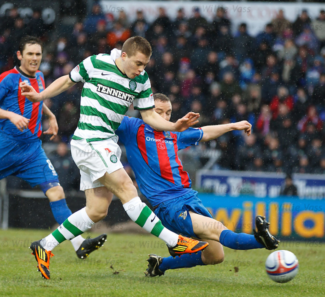 James Forrest shoots as David Proctor challenges but his shot goes narrowly wide