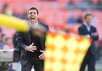D.C. United head coach Ben Olsen disputes a call with a referee during the game at the RFK Stadium in Washington DC.  Philadelphia defeated D.C. United, 3-2.