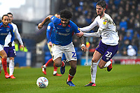 Ellis Harrison of Portsmouth is held by Sean Goss of Shrewsbury Town during Portsmouth vs Shrewsbury Town, Sky Bet EFL League 1 Football at Fratton Park on 15th February 2020
