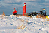 The sand covered beach lies cover with snow on a cold but sunny Febryary day, Grand Haven, Ottawa County, Michigan