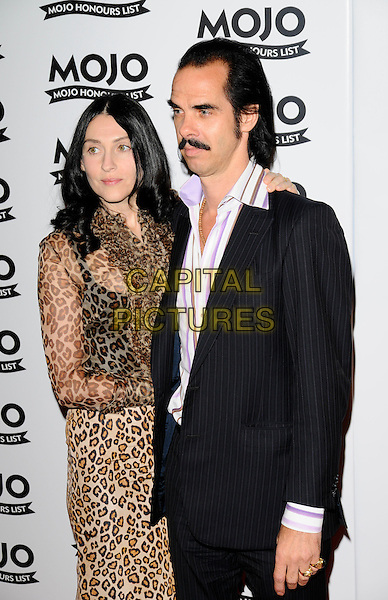 NICK CAVE & GUEST.At the Mojo Honours List Awards held at Old Truman Brewery, London, England, June 16th 2008. .arrivals half length black suit leopard print dress pinstripe moustache.CAP/CAN.©Can Nguyen/Capital Pictures